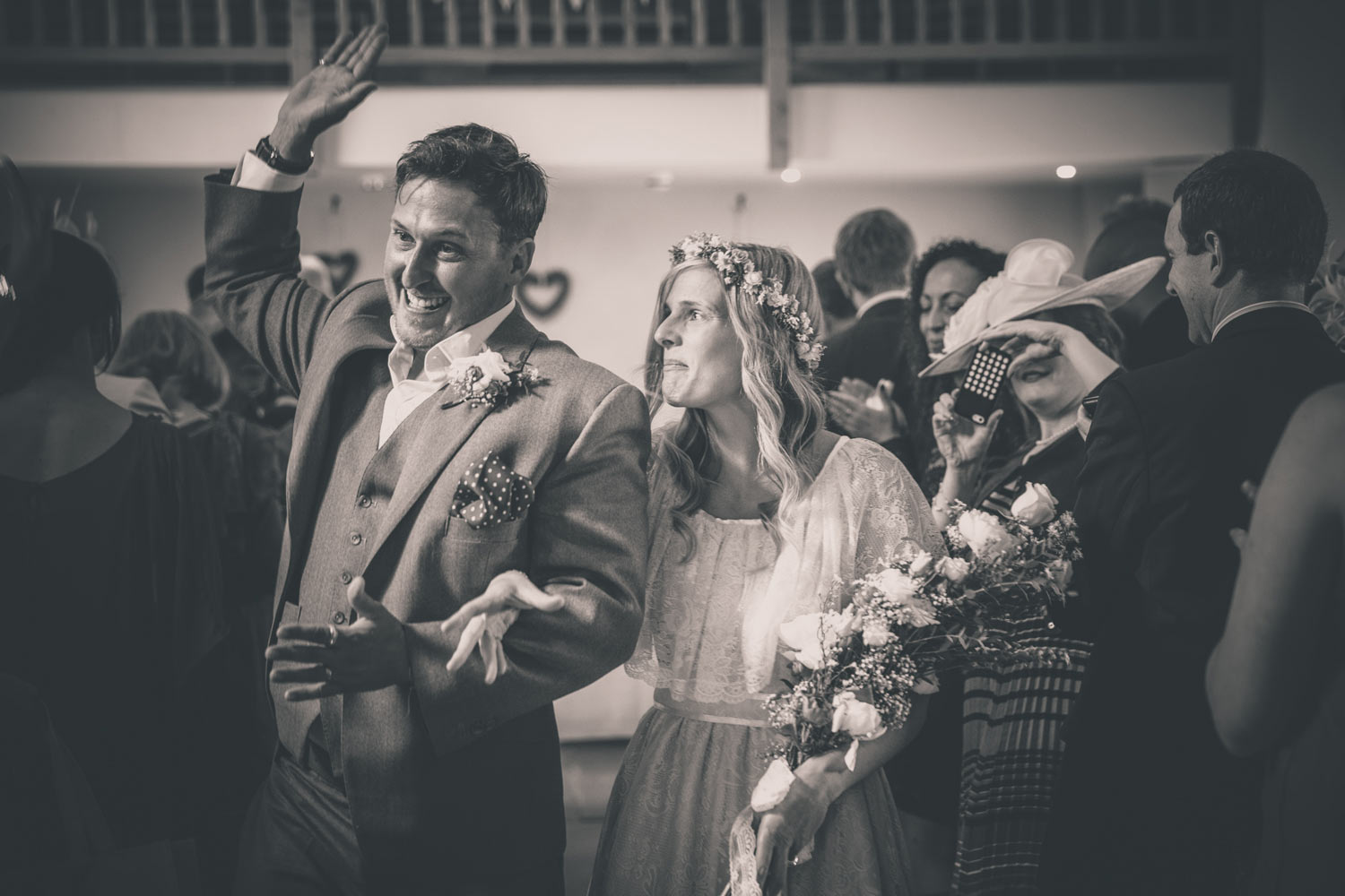 Walking down the aisle after wedding ceremony at the Ashes Leek